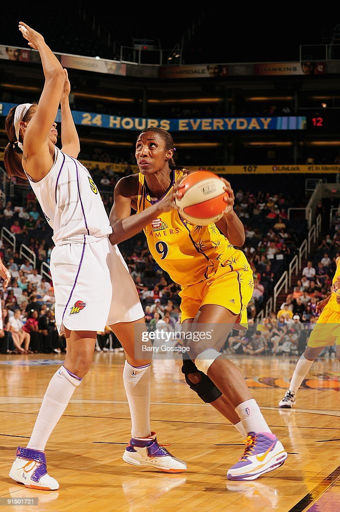 Lisa Leslie #9 of the Los Angeles Sparks drives the ball against Tangela Smith #50 of the Phoenix Mercury in Game Three of the Western Conference Finals during the 2009 WNBA Playoffs on September 26, 2009 at US Airways Center in Phoenix, Arizona. The Mercury won 85-74.