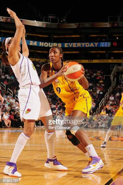 Lisa Leslie of the Los Angeles Sparks drives the ball against Tangela Smith of the Phoenix Mercury in Game Three of the Western Conference Finals...