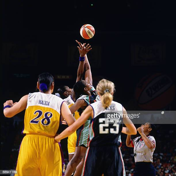 Lisa Leslie of the Los Angeles Sparks goes up for the opening tip off against the New York Liberty in the WNBA Season Opener at the Great Western...