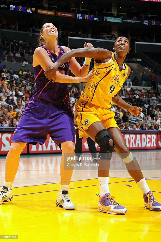 Lisa Leslie of the Los Angeles Sparks guards against Brooke Smith of the Phoenix Mercury on August 27 2009 at Staples Center in Los Angeles...