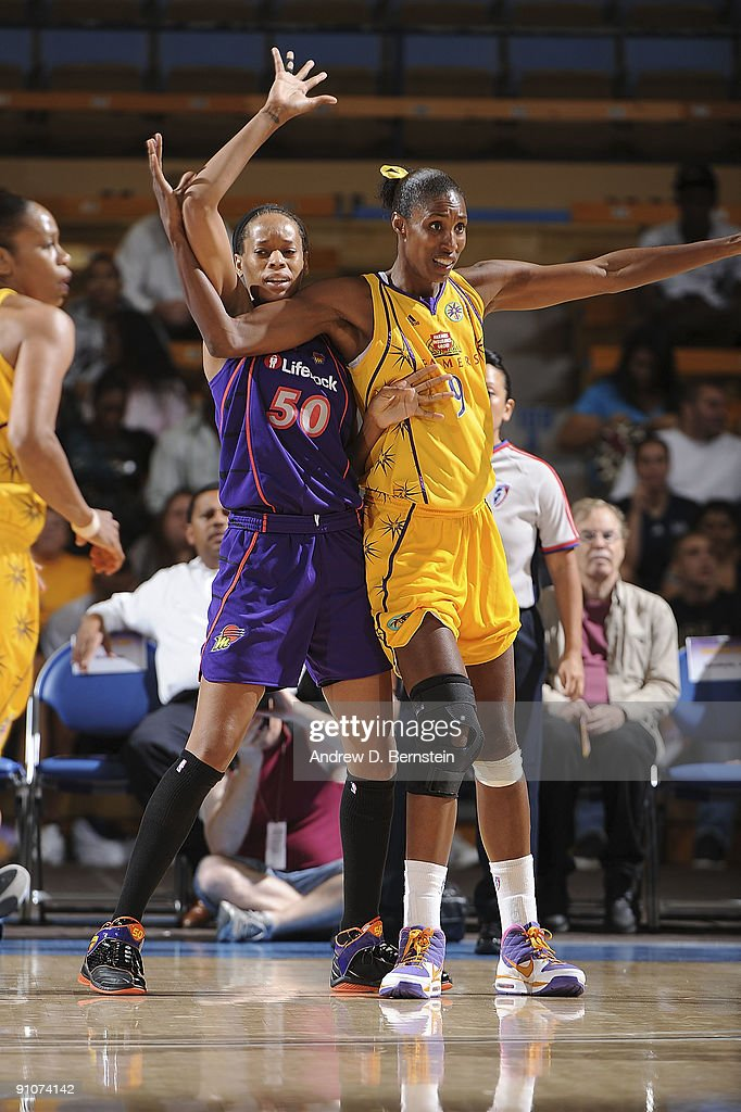 Lisa Leslie of the Los Angeles Sparks guards Tangela Smith of the Phoenix Mercury in Game One of the Western Conference Finals during the 2009 WNBA...