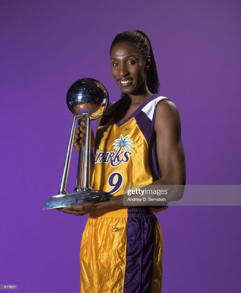 Lisa Leslie of the Los Angeles Sparks poses with her WNBA World Championship Trophy during Los Angeles Sparks Media Day in Los Angeles California on...