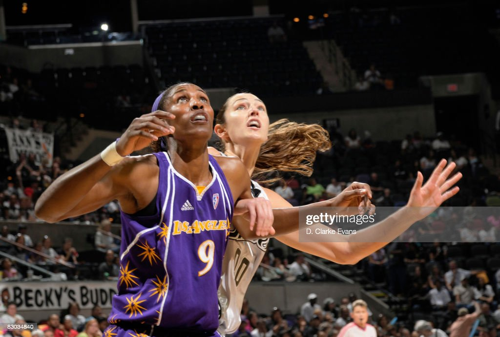 Lisa Leslie of the Los Angeles Sparks rebounds against Ruth Riley of the San Antonio Silver Stars in Game Two of the Western Conference Finals during...
