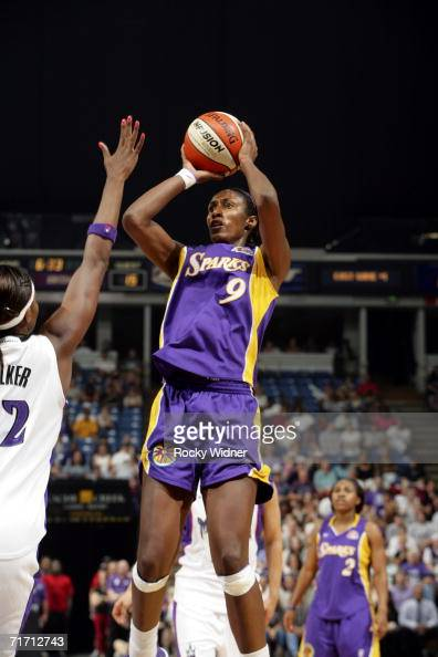 Lisa Leslie of the Los Angeles Sparks takes the open jump shot in front of DeMya Walker of the Sacramento Monarchs during game one of the 2006 WNBA...