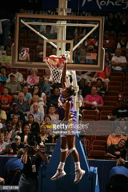 Lisa Leslie of the Western Conference AllStars dunks against the Eastern Conference AllStars during the 2005 WNBA AllStar Game on July 9 2005 at...
