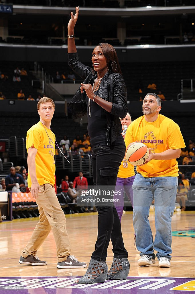 Lisa Leslie waves to the crowd during a game between the Los Angeles Spakrs and the Phoenix Mercury at STAPLES Center on September 19, 2013 in Los Angeles, California.
