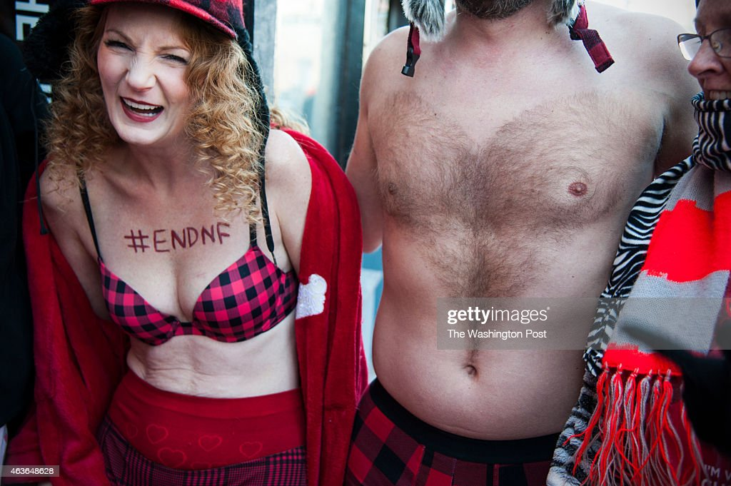 Lisa Levinski and Josh Suchy, who shaved a heart into his chest hair try to stay warm before the Cupid's Undie Run February, 15, 2015 in Washington, DC.