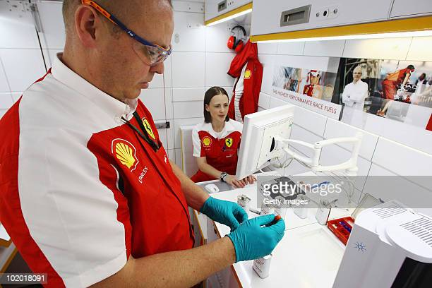 Lisa Lilley Shell Technology Manager for Ferrari and Shell technician Mark Farley are seen in the Shell Track Laboratory during qualifying for the...