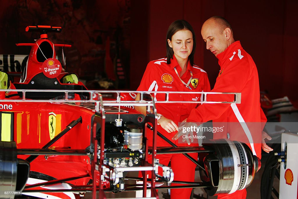 Lisa Lilley talks with fellow Shell team member Mike Copson in the garage during the practice session for the San Marino F1 Grand Prix at the San...