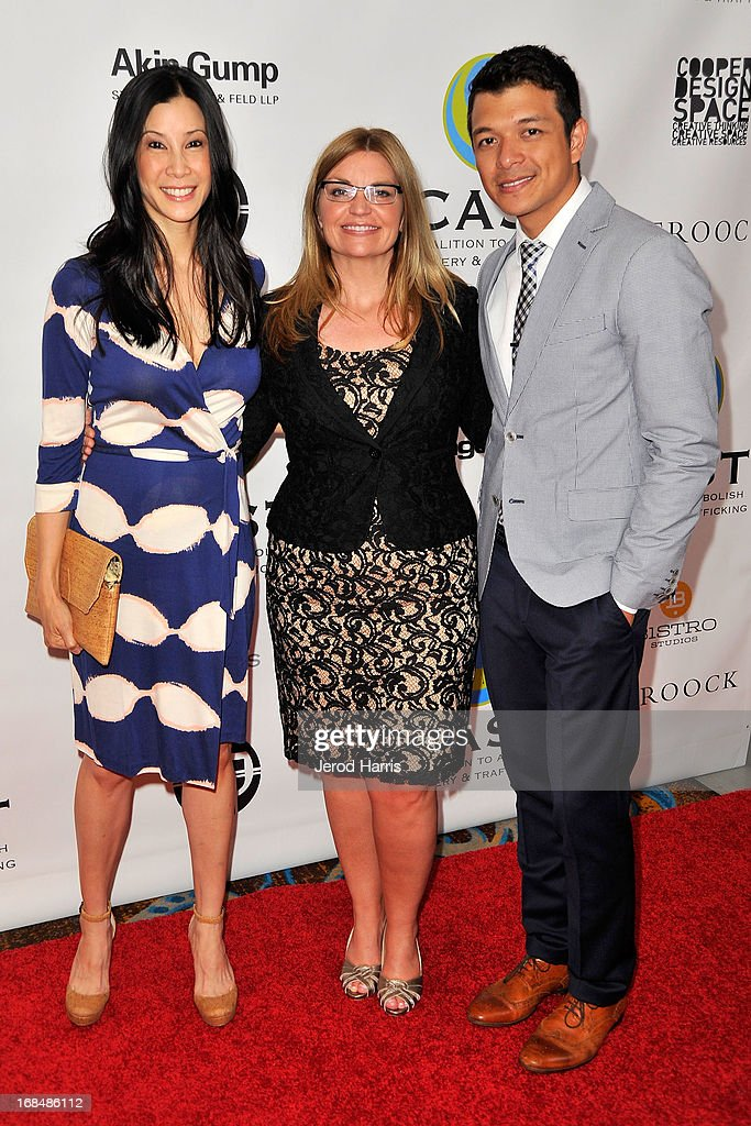 Lisa Ling, CEO of CAST Kay Buck and Jericho Rosales arrive at the Coalition To Abolish Slavery and Trafficking's 15th Annual From Slavery to Freedom gala at the Sofitel Hotel on May 9, 2013 in Los Angeles, California.