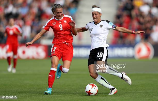 Lisa Makas of Austria and Ana Maria Cmogorcevic of Switzerland compete for the ball during the Group C match between Austria and Switzerland during...