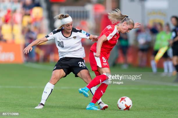 Lisa Makas of Austria and AnaMaria Crnogoreevic of Switzerland battle for the ball during the Group C match between Austria and Switzerland during...