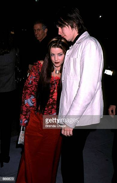 Lisa Marie Presley and John Oszajca attend the 'Tommy Hilfiger Vanity Fair Icons of Rock' party November 11 1999 in Beverly Hills CA According to a...