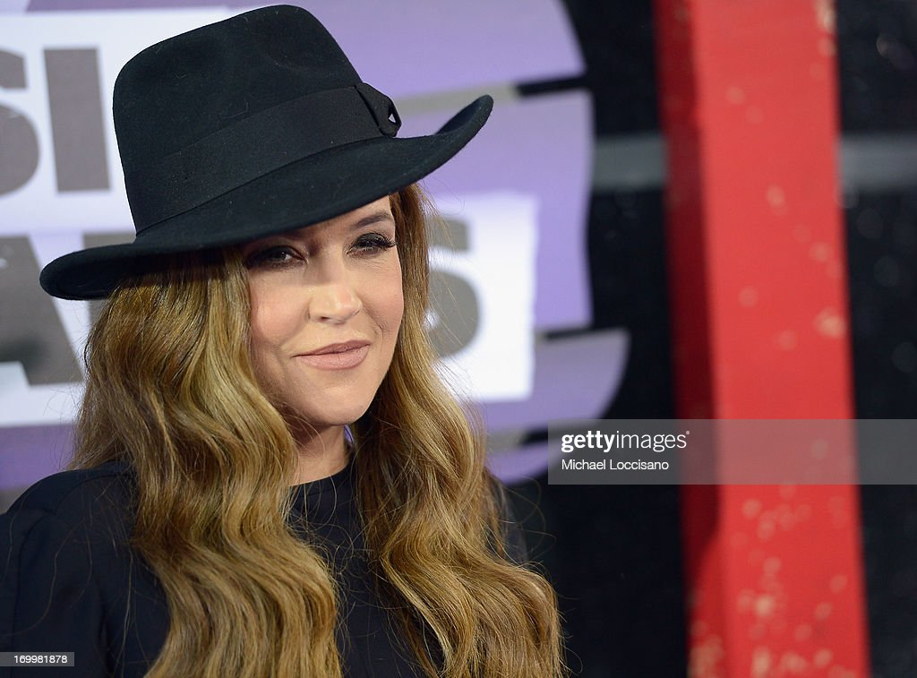 <a gi-track='captionPersonalityLinkClicked' href=/galleries/search?phrase=Lisa+Marie+Presley&family=editorial&specificpeople=202037 ng-click='$event.stopPropagation()'>Lisa Marie Presley</a> attends the 2013 CMT Music awards at the Bridgestone Arena on June 5, 2013 in Nashville, Tennessee.