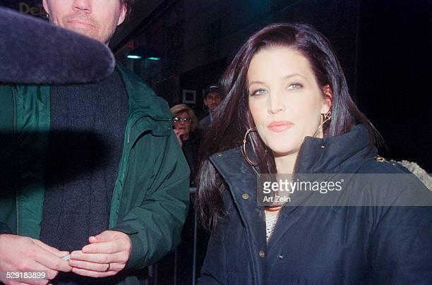 Lisa Marie Presley wearing a down coat circa 1990 New York
