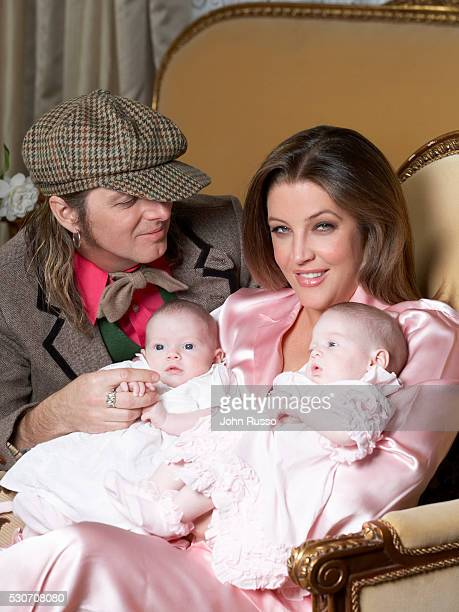 Lisa Marie Presley with her husband and fraternal twin daughters