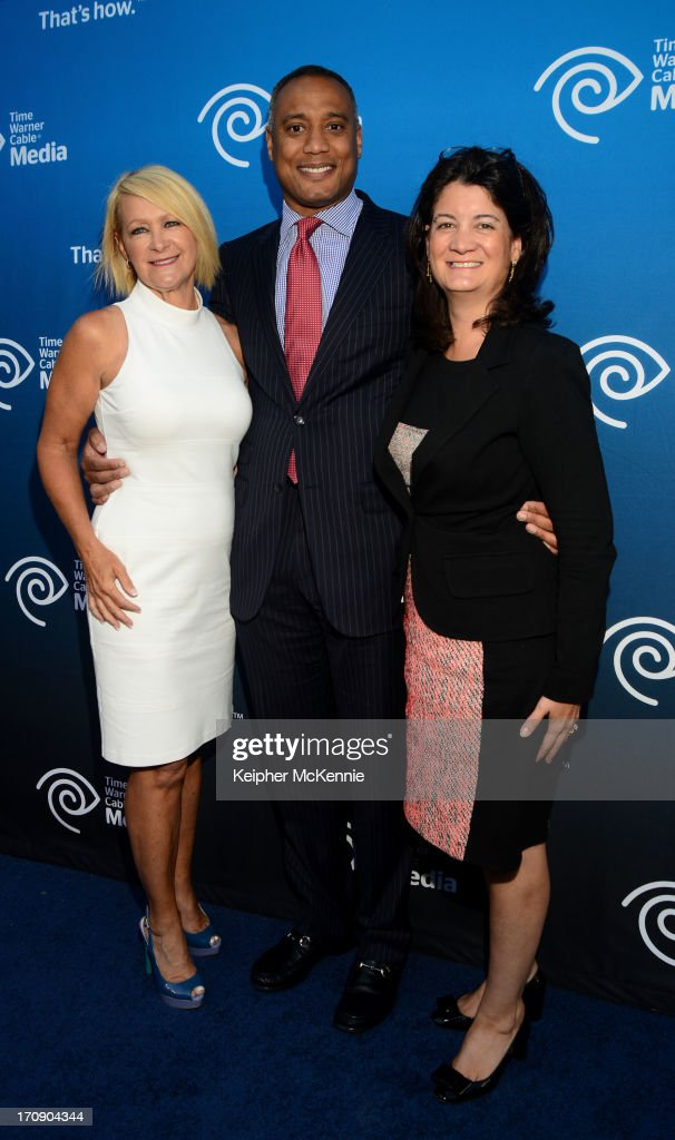 9 (L-R) TWC SVP Lisa Meier, President of Sports and Local News David Rone and EVP/COO Joan Gillman arrive to Time Warner Cable (TWC Media) 'View From The Top' Upfront honoring LA Lakers' Dr. Jerry Buss at Vibiana on June 19, 2013 in Los Angeles, California. (Photo by Keipher McKennie/WireImage)WireImage)