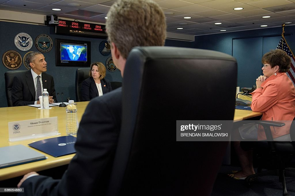 Lisa Monaco (2L), a White House Homeland Security advisor, Shaun Donovan (2R), Director of the Office of Management and Budget, and Valerie Jarrett (R), a White House advisor, listen as US President Barack Obama makes a statement to the press about hurricane season at the Federal Emergency Management Agency(FEMA)on May 31, 2016 in Washington, DC. / AFP / Brendan Smialowski