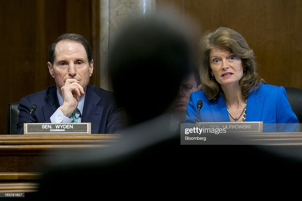 Lisa Murkowski, a Republican from Alaska, right, questions Sally Jewell, president and chief executive officer of Recreational Equipment Inc. (REI) and nominee for U.S. Interior secretary, center, during a Senate Energy and Natural Resources Committee hearing with Ronald 'Ron' Wyden, a Democrat from Oregon, in Washington, D.C., U.S., on Thursday, March 7, 2013. Jewell disclosed she owns shares in companies such as ConocoPhillips and Exxon Mobil Corp., which hold drilling leases managed by the Interior Department. Photographer: Andrew Harrer/Bloomberg via Getty Images
