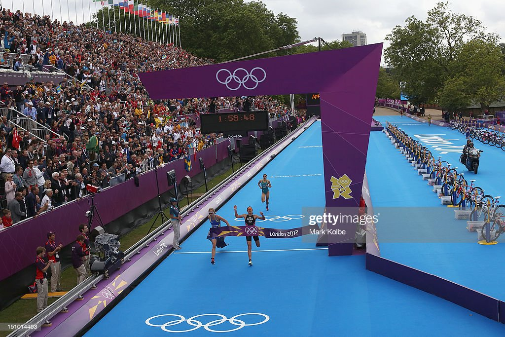 Lisa Norden of Sweden (L) and Nicola Spirig of Switzerland finish the Women's Triathlon on Day 8 of the London 2012 Olympic Games at Hyde Park on August 4, 2012 in London, England.
