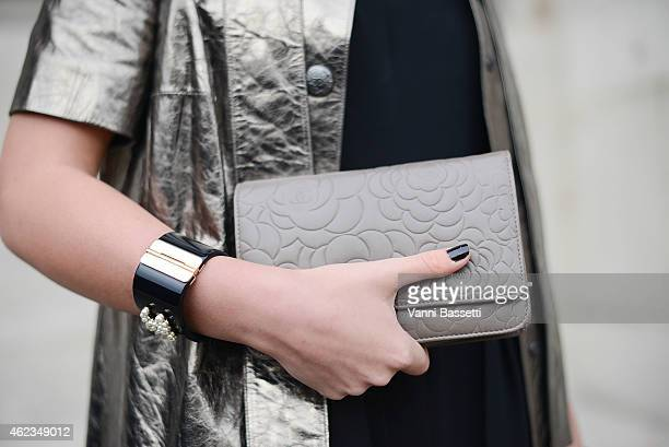 Lisa Novozhilova poses wearing a Chanel total look during day 3 of Paris Haute Couture Spring Summer 2015 on January 27 2015 in Paris France