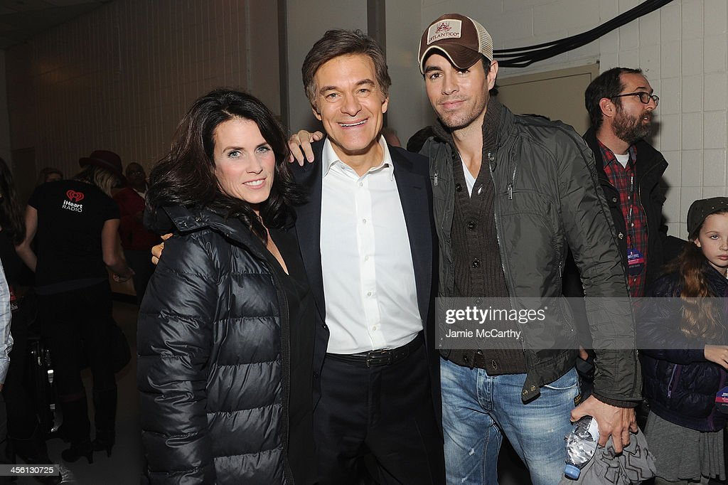 Lisa Oz, Dr. Mehmet Oz and Enrique Iglesias pose backstage at Z100's Jingle Ball 2013, presented by Aeropostale, at Madison Square Garden on December 13, 2013 in New York City.
