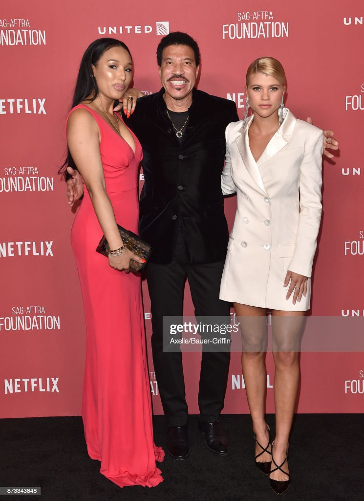Lisa Parigi, singer Lionel Richie and daughter Sofia Richie arrive at SAG-AFTRA Foundation Patron of the Artists Awards 2017 on November 9, 2017 in Beverly Hills, California.
