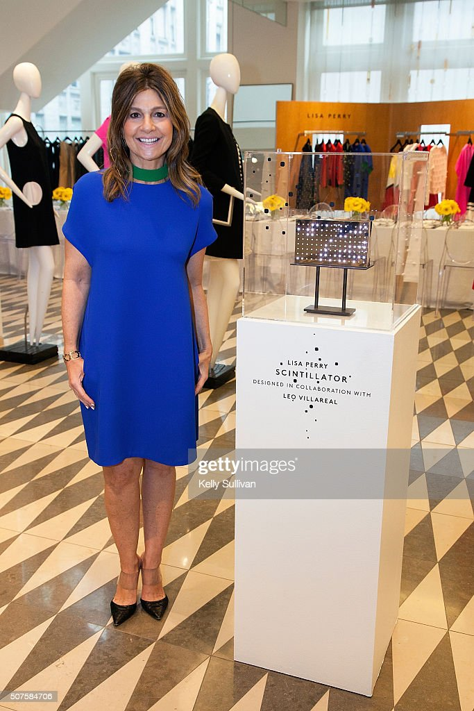 Lisa Perry poses with her Scintillator clutch at Barneys New York on January 29 2016 in San Francisco California