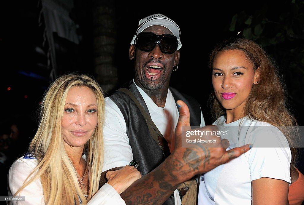Lisa Pliner, <a gi-track='captionPersonalityLinkClicked' href=/galleries/search?phrase=Dennis+Rodman&family=editorial&specificpeople=202643 ng-click='$event.stopPropagation()'>Dennis Rodman</a>, and Alexis Rodman attend the Minimale Animale show during Mercedes-Benz Fashion Week Swim 2014 at Oasis at the Raleigh on July 22, 2013 in Miami, Florida.