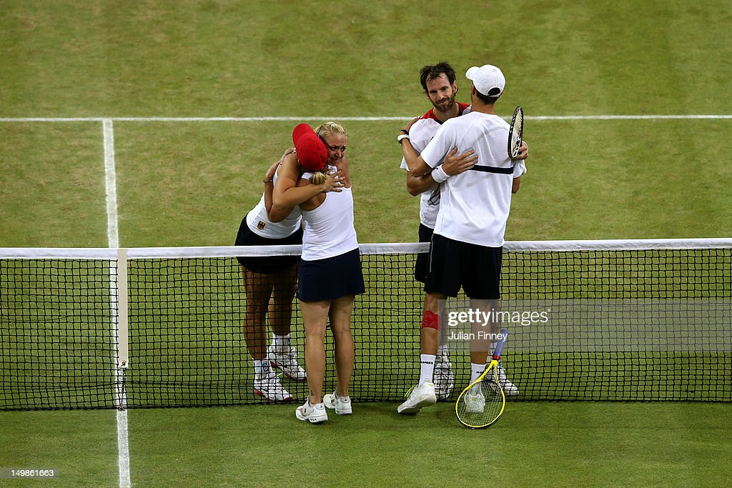 Lisa Raymond of the United States and Mike Bryan of the United States greet Sabine Lisicki of Germany and Christopher Kas of Germany at the net after...