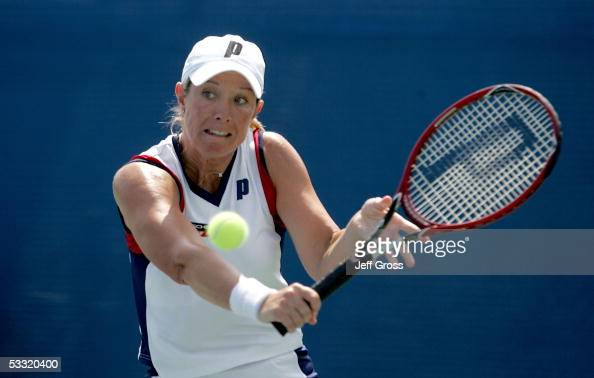Lisa Raymond of the USA hits a backhand while playing against Sesil Karatantcheva of Bulgaria during the Acura Classic at the La Costa Resort and Spa...