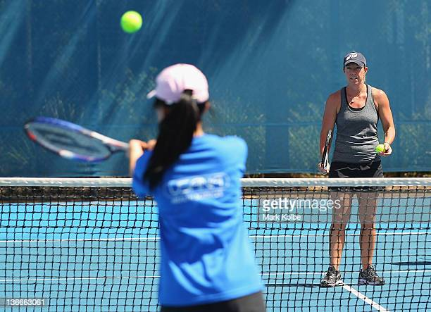 Lisa Raymond of the USA runs training drills at a coaching clinic during day three of the 2012 Sydney International at Sydney Olympic Park Tennis...