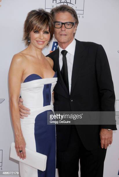 Lisa Rinna and Harry Hamlin arrive at the 21st Annual Race To Erase MS Gala at the Hyatt Regency Century Plaza on May 2 2014 in Century City...