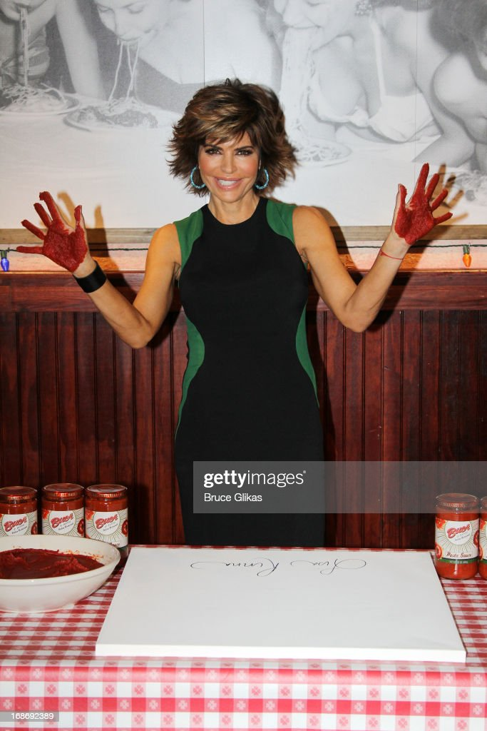 <a gi-track='captionPersonalityLinkClicked' href=/galleries/search?phrase=Lisa+Rinna&family=editorial&specificpeople=202100 ng-click='$event.stopPropagation()'>Lisa Rinna</a> promotes 'The Celebrity Apprentice' with a Marinara Sauce Handprint Ceremony at Buca di Beppo on May 13, 2013 in New York City.