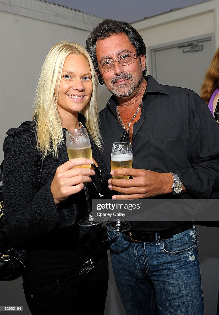 Lisa Runyan (L) and Rob Mione of Optometrix attend Los Angeles Confidential Magazine's Luxury Showcase at the Luxe Hotel on September 12, 2008 in Beverly Hills, California.