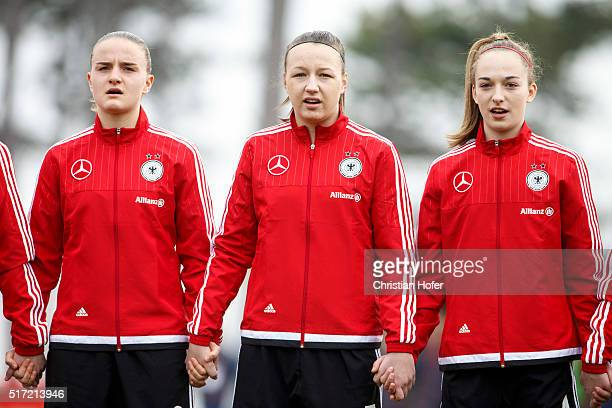 Lisa Schoeppl Tanja Pawollek and Sophia Kleinherne of Germany line up during the national anthem prior to the U17 Girl's Euro Qualifier match between...