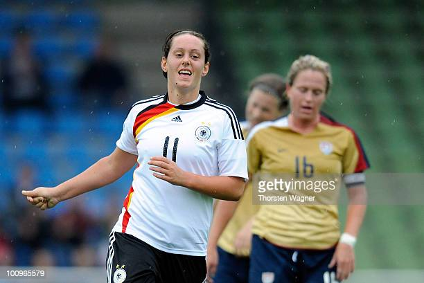 Lisa Schwab of Germany celebrates after scoring her team's first goal during the U23 international friendly match between Germany and USA at Georg...