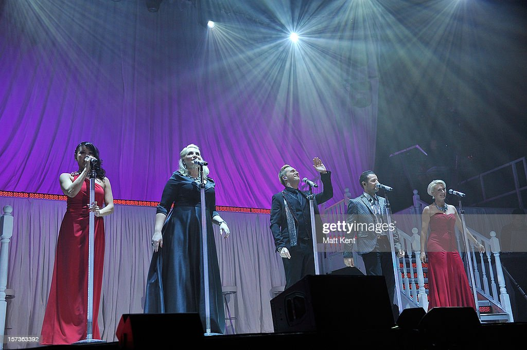 Lisa Scott-Lee, <a gi-track='captionPersonalityLinkClicked' href=/galleries/search?phrase=Claire+Richards&family=editorial&specificpeople=216222 ng-click='$event.stopPropagation()'>Claire Richards</a>, <a gi-track='captionPersonalityLinkClicked' href=/galleries/search?phrase=Ian+%27H%27+Watkins+-+Steps&family=editorial&specificpeople=217387 ng-click='$event.stopPropagation()'>Ian 'H' Watkins</a>, <a gi-track='captionPersonalityLinkClicked' href=/galleries/search?phrase=Lee+Latchford-Evans&family=editorial&specificpeople=218137 ng-click='$event.stopPropagation()'>Lee Latchford-Evans</a> and <a gi-track='captionPersonalityLinkClicked' href=/galleries/search?phrase=Faye+Tozer&family=editorial&specificpeople=206566 ng-click='$event.stopPropagation()'>Faye Tozer</a> of Steps perform at London Palladium on December 2, 2012 in London, England.