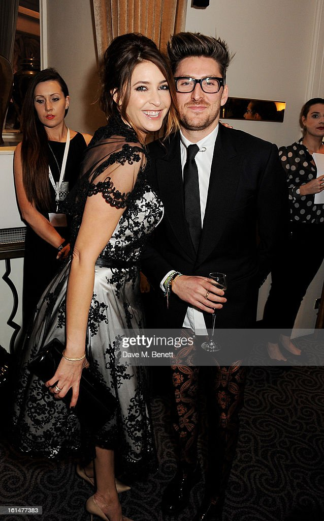 Lisa Snowdon (L) and <a gi-track='captionPersonalityLinkClicked' href=/galleries/search?phrase=Henry+Holland+-+Fashion+Designer&family=editorial&specificpeople=1637233 ng-click='$event.stopPropagation()'>Henry Holland</a> arrive at the Elle Style Awards at The Savoy Hotel on February 11, 2013 in London, England.