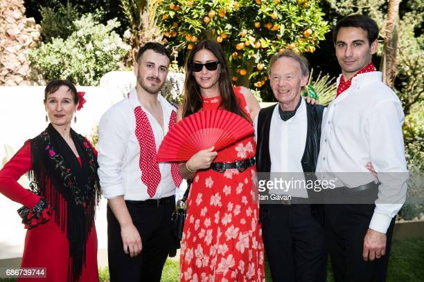 Lisa Snowdon poses with traditional Spanish flamenco dancers at the RHS Chelsea Flower Show on May 22 2017 in London United Kingdom With Their...