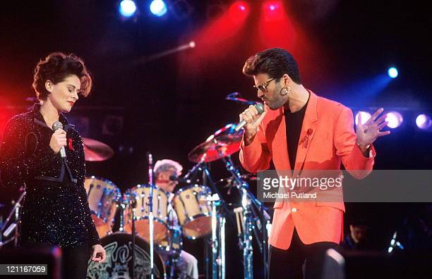 Lisa Stansfield and George Michael perform on stage with Roger Taylor of Queen at the Freddie Mercury Tribute Concert Wembley Stadium London 20th...