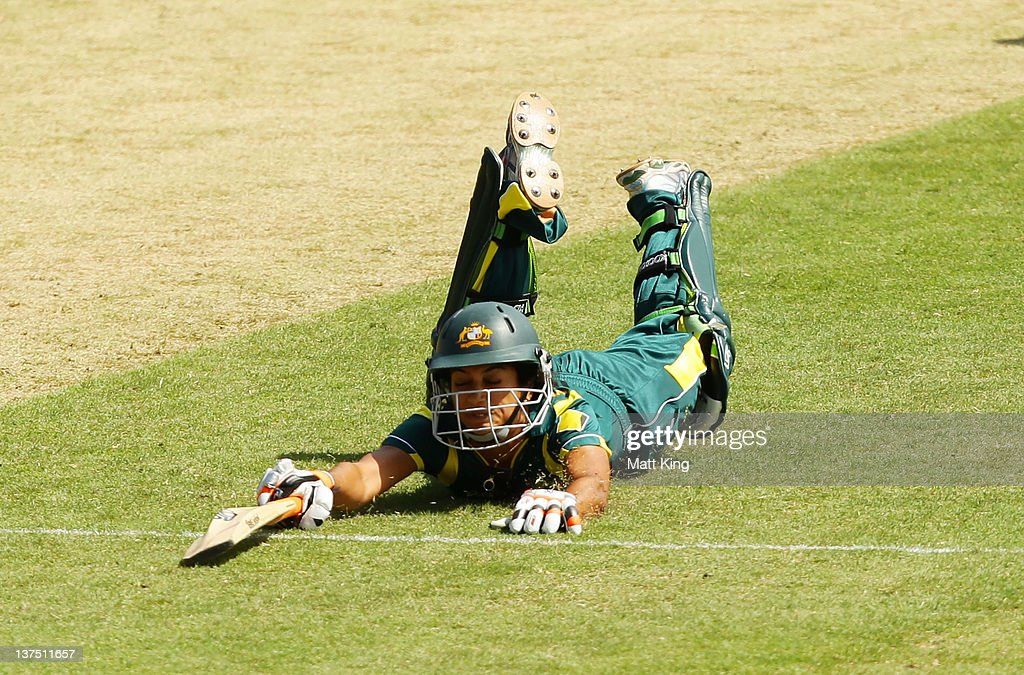 <a gi-track='captionPersonalityLinkClicked' href=/galleries/search?phrase=Lisa+Sthalekar&family=editorial&specificpeople=178307 ng-click='$event.stopPropagation()'>Lisa Sthalekar</a> of Australia slides home for a run during the Women's Twenty20 match between the Australian Southern Stars and New Zealand at North Sydney Oval on January 22, 2012 in Sydney, Australia.