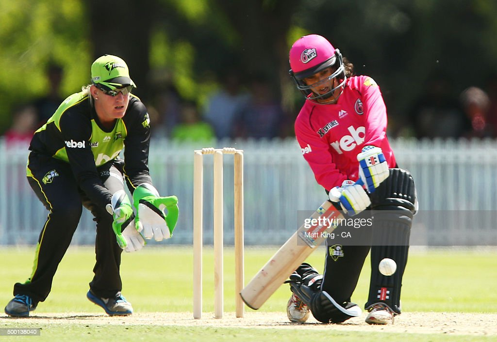 <a gi-track='captionPersonalityLinkClicked' href=/galleries/search?phrase=Lisa+Sthalekar&family=editorial&specificpeople=178307 ng-click='$event.stopPropagation()'>Lisa Sthalekar</a> of the Sixers bats as Claire Koski of the Thunder keeps wicket during the Women's Big Bash League match between the Sydney Thunder and the Sydney Sixers at Howell Oval on December 6, 2015 in Sydney, Australia.