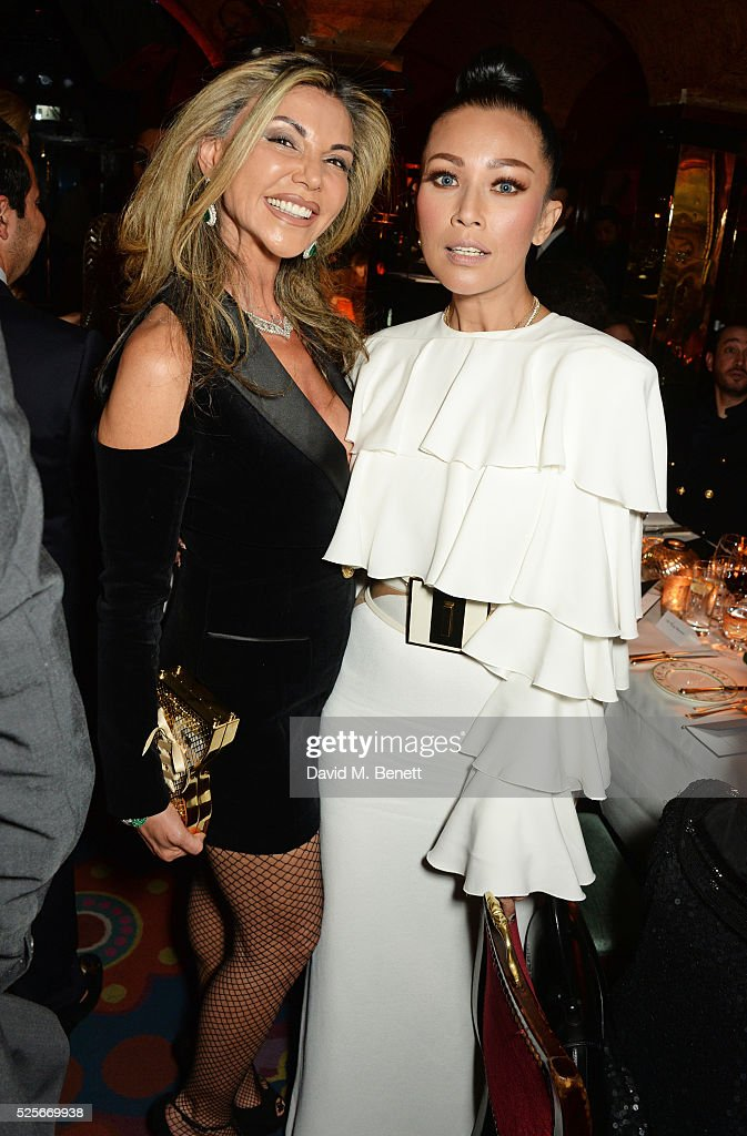 Lisa Tchenguiz (L) and Princess Datin Ezurin of Malaysia attend a private dinner hosted by Fawaz Gruosi, founder of de Grisogono, at Annabels on April 28, 2016 in London, England.