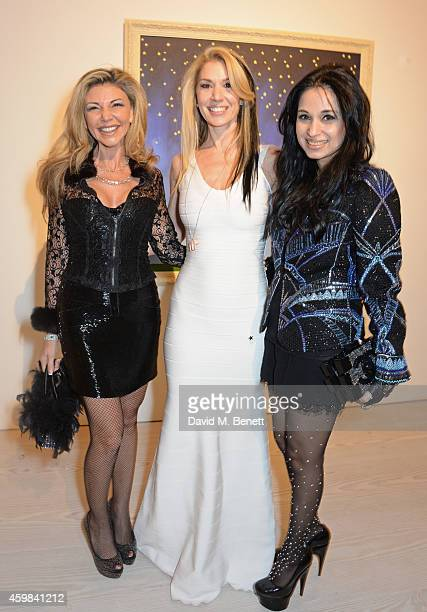 Lisa Tchenguiz Stasha Palos and Sheetal Mafatlal attend a private view of 'And The Stars Shine Down' by Stasha Palos at the Saatchi Gallery on...