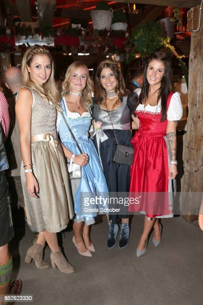 Lisa Ulreich wife of Sven Ulreich Elena Rudy wife of FC Bayern soccer player Sebastian Rudy Cathy Hummels wearing a dirndl by Angermaier Trachten and...