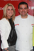 Lisa Valastro and husband Buddy Valastro attend a breakfast marking the opening of the Cake Boss Cafe at Discovery Times Square on May 1 2013 in New...