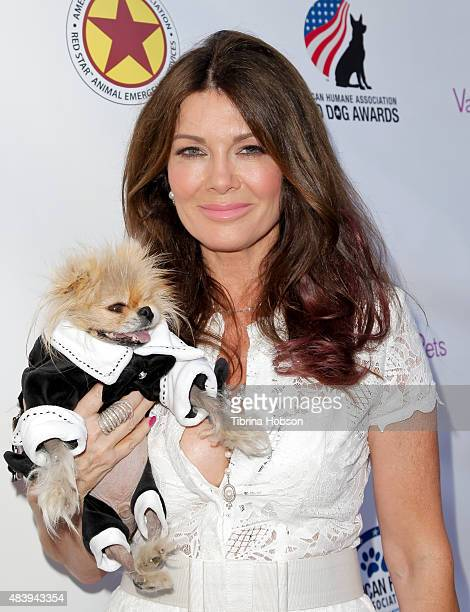 Lisa Vanderpump and Giggy attend her luncheon benefitting the American Humane Association and the Hero Dog Awards at Pump on August 13 2015 in West...