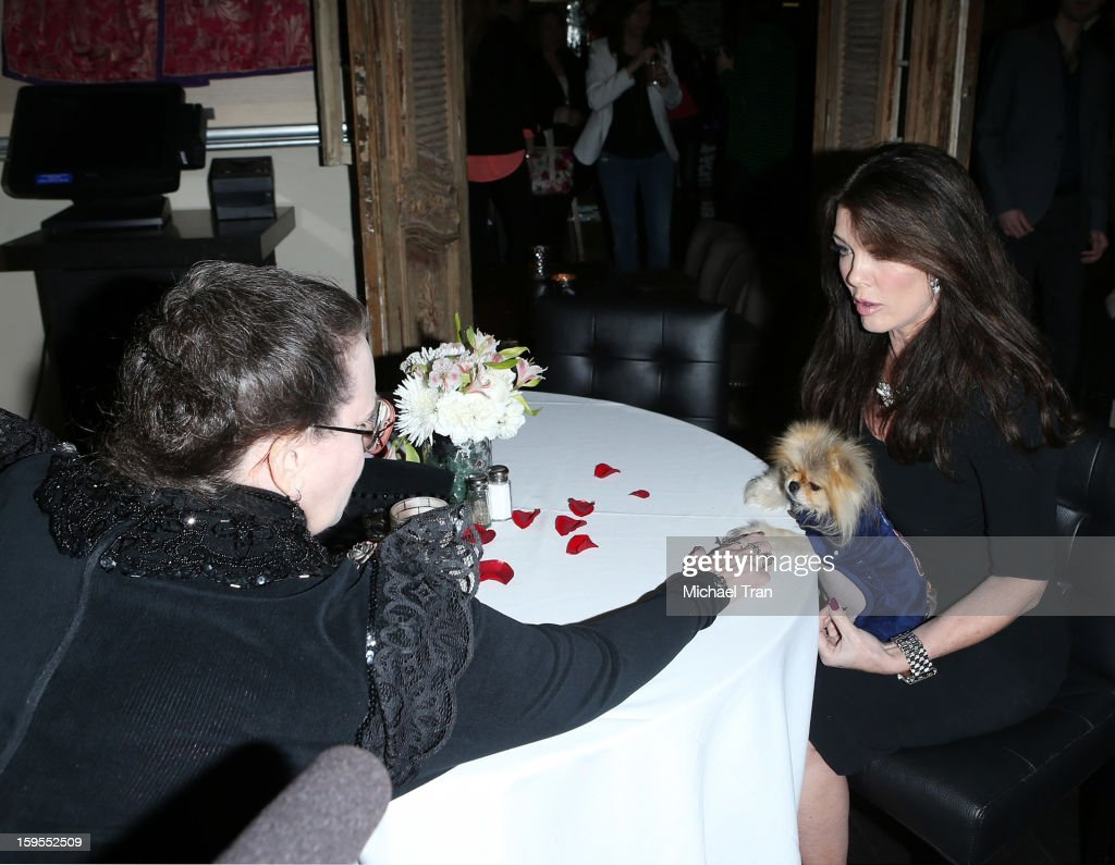 <a gi-track='captionPersonalityLinkClicked' href=/galleries/search?phrase=Lisa+Vanderpump&family=editorial&specificpeople=6834933 ng-click='$event.stopPropagation()'>Lisa Vanderpump</a> and Giggy get a psychic reading at the 'How Lavish Will Your 2013 Be?' event held at Sur Restaurant on January 15, 2013 in Los Angeles, California.