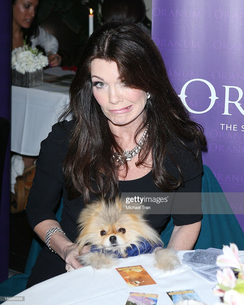 Lisa Vanderpump and Giggy get a psychic reading at the 'How Lavish Will Your 2013 Be?' event held at Sur Restaurant on January 15, 2013 in Los Angeles, California.